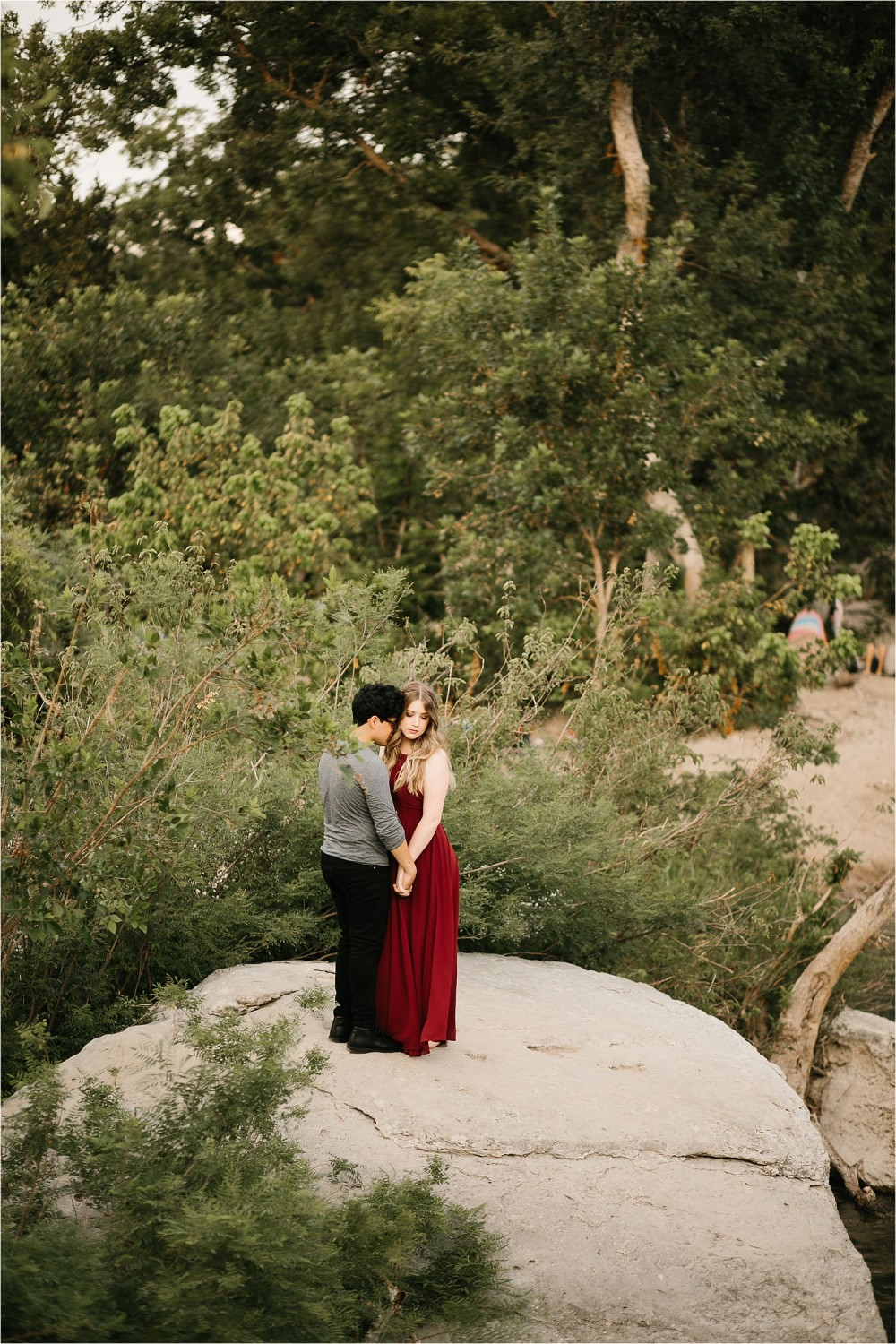 Romantic Austin, Texas Engagement Session with outfit inspiration + flowy red dress from Lulu's at Mckinney Falls State Park by North Texas Wedding Photographer, Rachel Meagan Photography __ 26