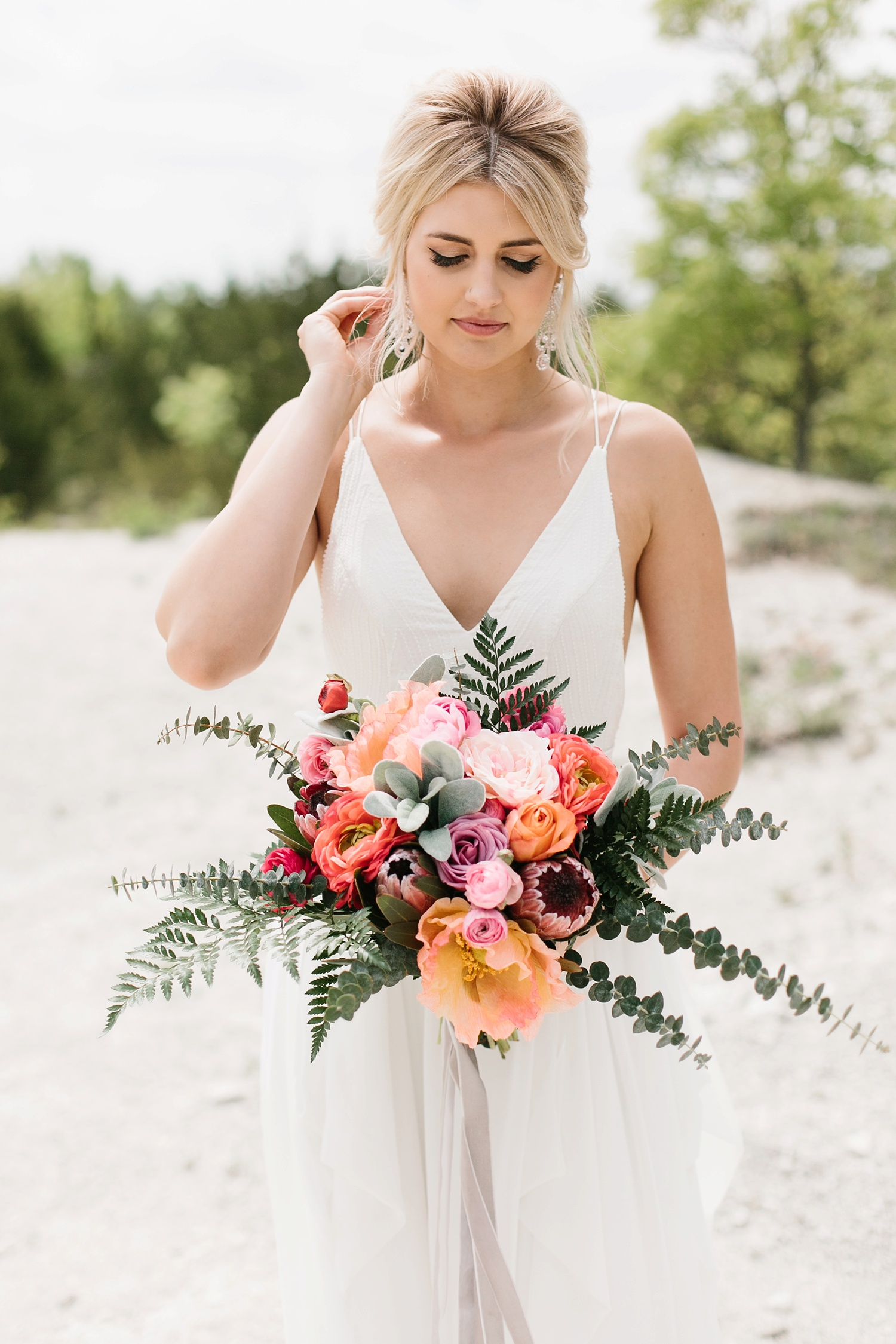 a breathtaking, rich, delicately vibrant Spring wedding accented with stunning faux florals at Stonecrest Event Venue by North Texas Wedding Photographer Rachel Meagan Photography _52