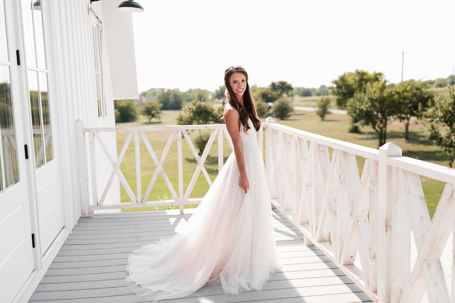 an all white minimialist style bridal session with burgundy and blush accents at The Nest at Ruth Farms in Ponder, Texas by North Texas Wedding Photographer Rachel Meagan Photography070