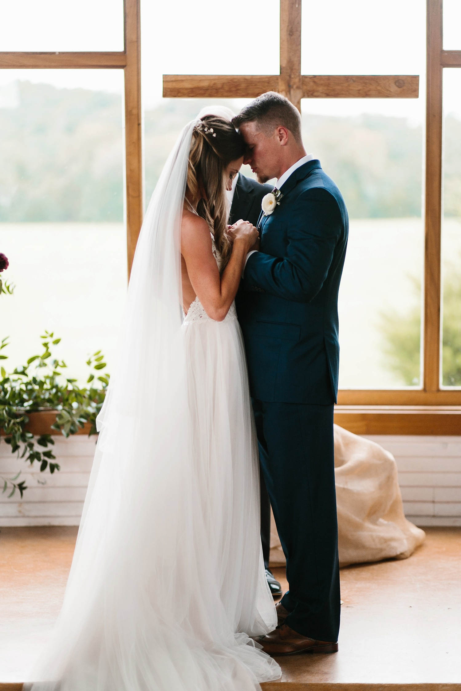 a passionate, emotion filled summer wedding with with navy and burgandy accents at The Brooks at Weatherford by North Texas Wedding Photographer, Rachel Meagan Photography _055