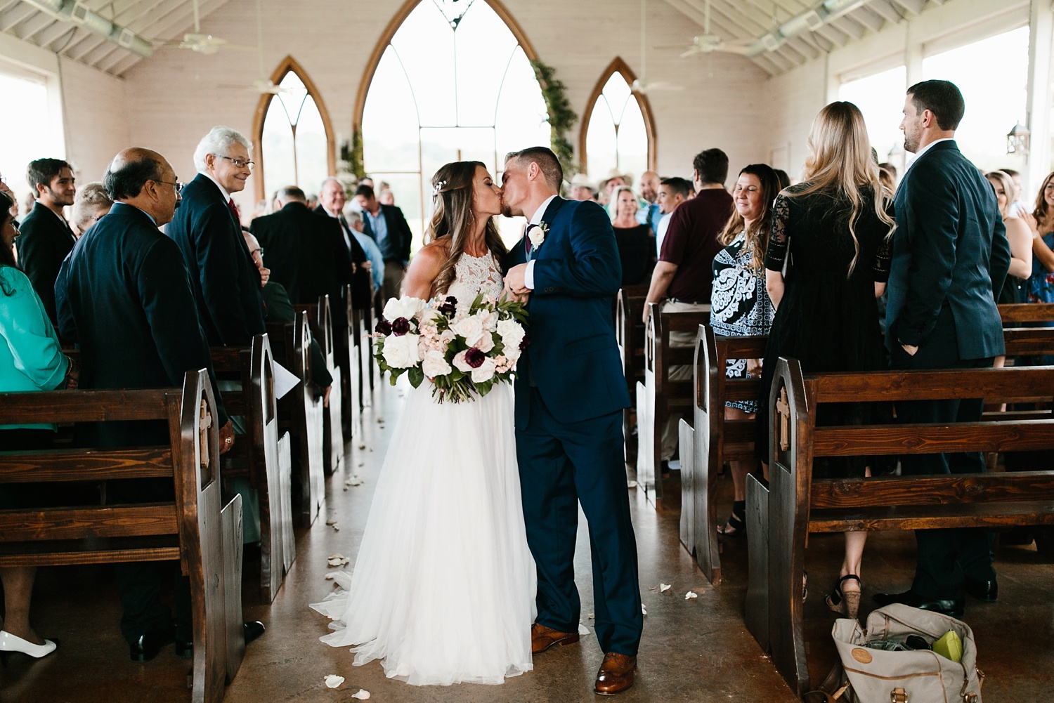 a passionate, emotion filled summer wedding with with navy and burgandy accents at The Brooks at Weatherford by North Texas Wedding Photographer, Rachel Meagan Photography _059