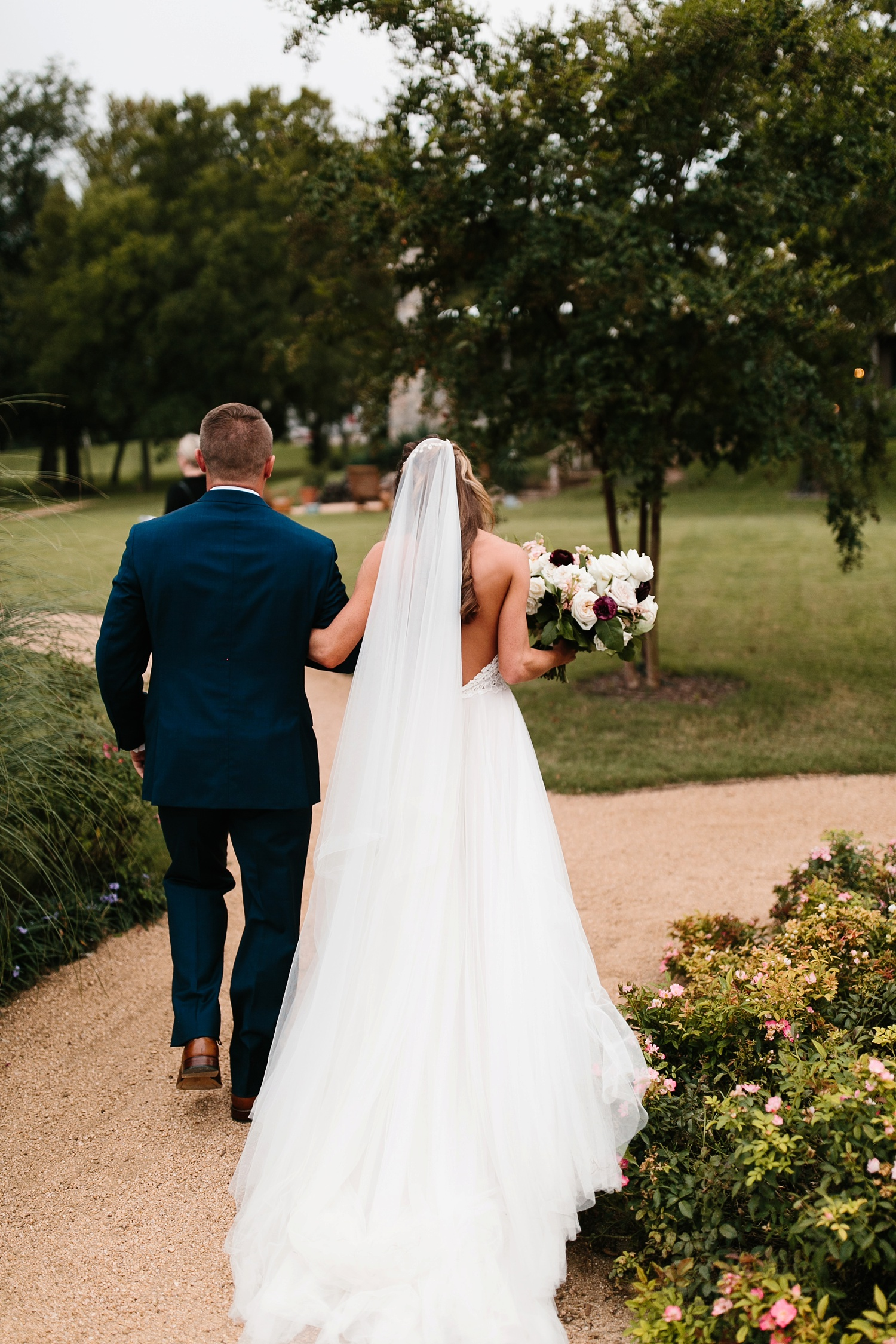 a passionate, emotion filled summer wedding with with navy and burgandy accents at The Brooks at Weatherford by North Texas Wedding Photographer, Rachel Meagan Photography _061