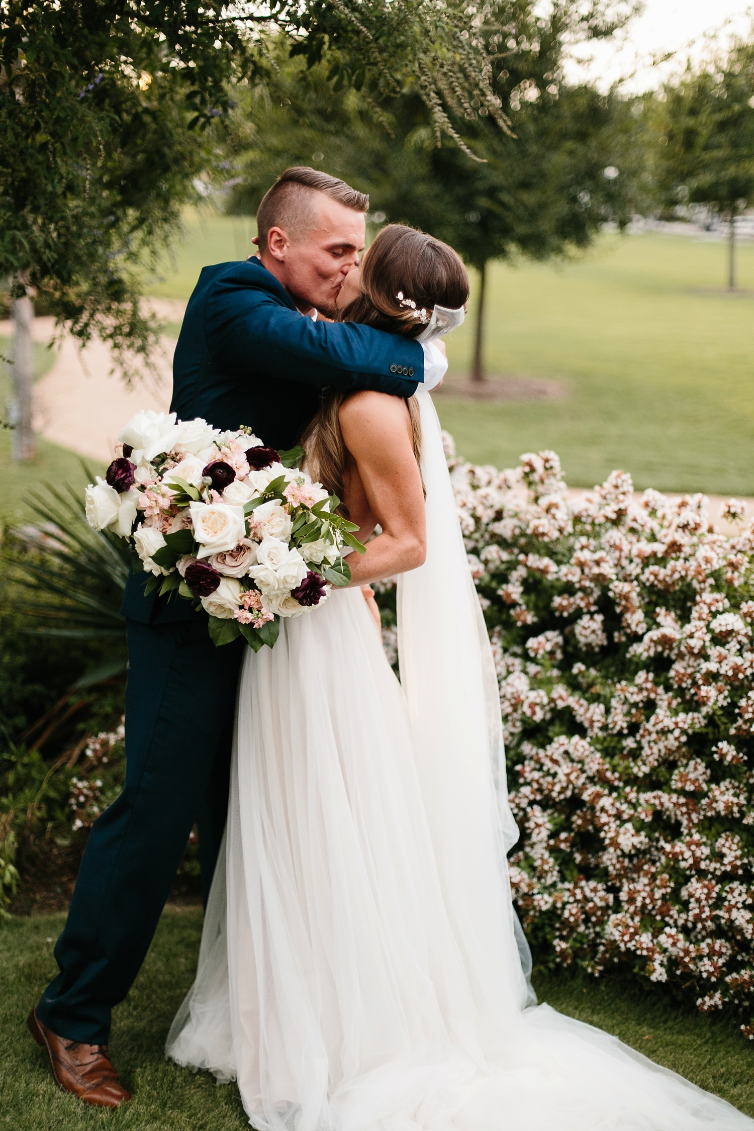 a passionate, emotion filled summer wedding with with navy and burgandy accents at The Brooks at Weatherford by North Texas Wedding Photographer, Rachel Meagan Photography _078