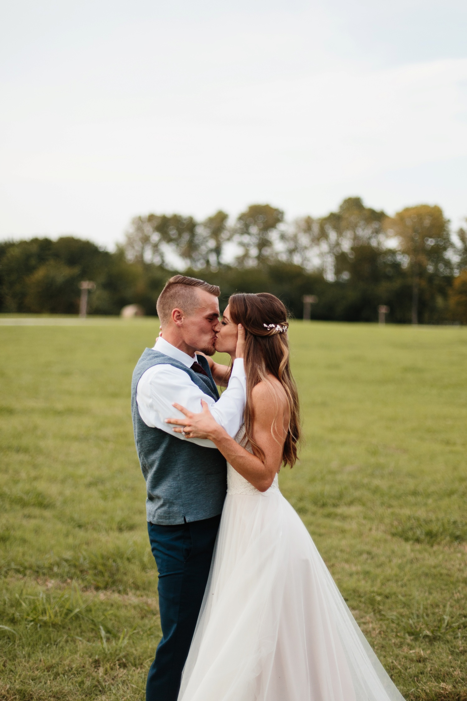 a passionate, emotion filled summer wedding with with navy and burgandy accents at The Brooks at Weatherford by North Texas Wedding Photographer, Rachel Meagan Photography _099